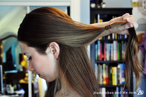 Tie the front sections into a loose ponytail—don't make it too close to your head or you won't have room to twist.
