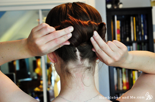 Once you've got a bun/roll, make sure the loose ends are tucked in behind the roll and pin it down. I use a combination of large bobby pins and hair pins.